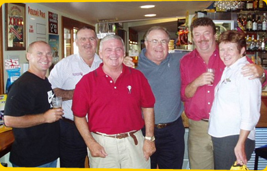 Allan Langer, Billy J Smith, Chris 'Budda' Handy and Mark from XXXX drop in for a drink with the Hotel's Bob and Julie Porter